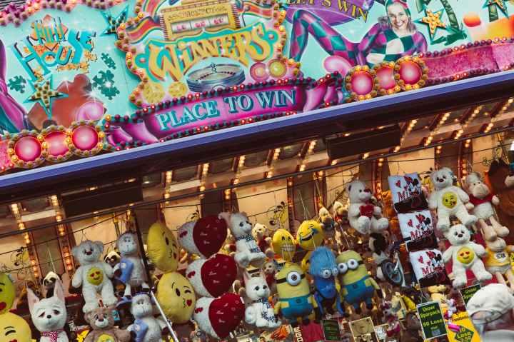 minion plush toy beside blue devil minion plush toy