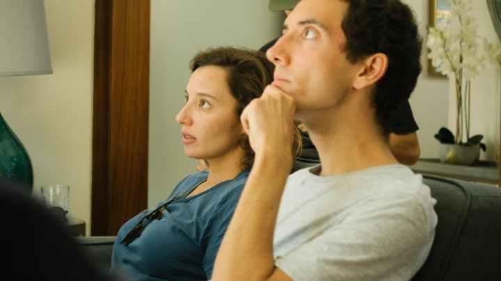 man sitting beside woman
