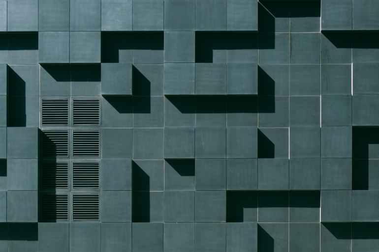 gray concrete building exterior with geometric design