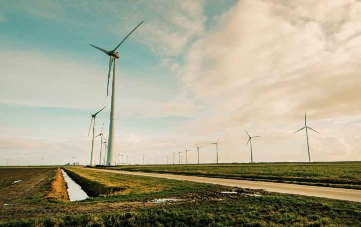 windmill energy on green grass field