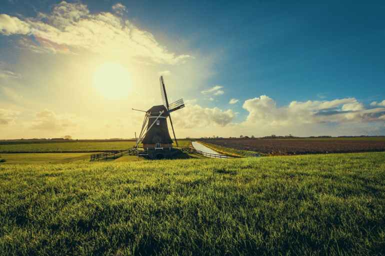 vintage black windmill during sunset