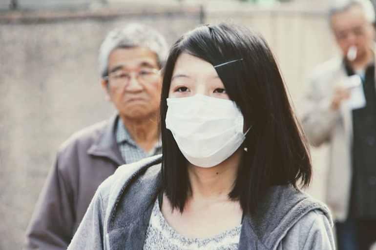 woman-wearing-mouth-mask